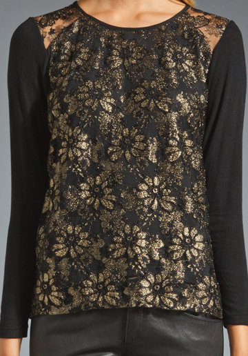 The lace and sheer detailing on this Generation Love Phoenix metallic lace long-sleeve combo sweater ($160) make it perfect for holiday cocktails after work.