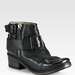 Channel the tougher, biker-inspired edge with these Elisanero Leather Buckle and Zipper Ankle Boots ($760).