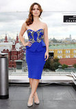 At the Skyfall Moscow photocall, Bérénice Marlohe showed off her svelte curves in a cobalt blue strapless Julien Macdonald dress.