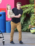 Brooklyn Beckham carried Harper Beckham on a shopping day.