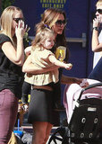Victoria Beckham carried Harper on a shopping trip.