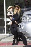 Rachel Zoe carried her son, Skyler Berman.