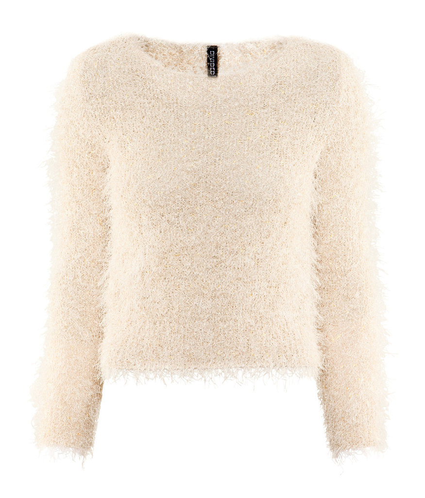 This ultrafeminine Winter white H&M Shag Sweater ($18) is soft, shimmery, and perfect for pairing with silk pleated maxi skirts.