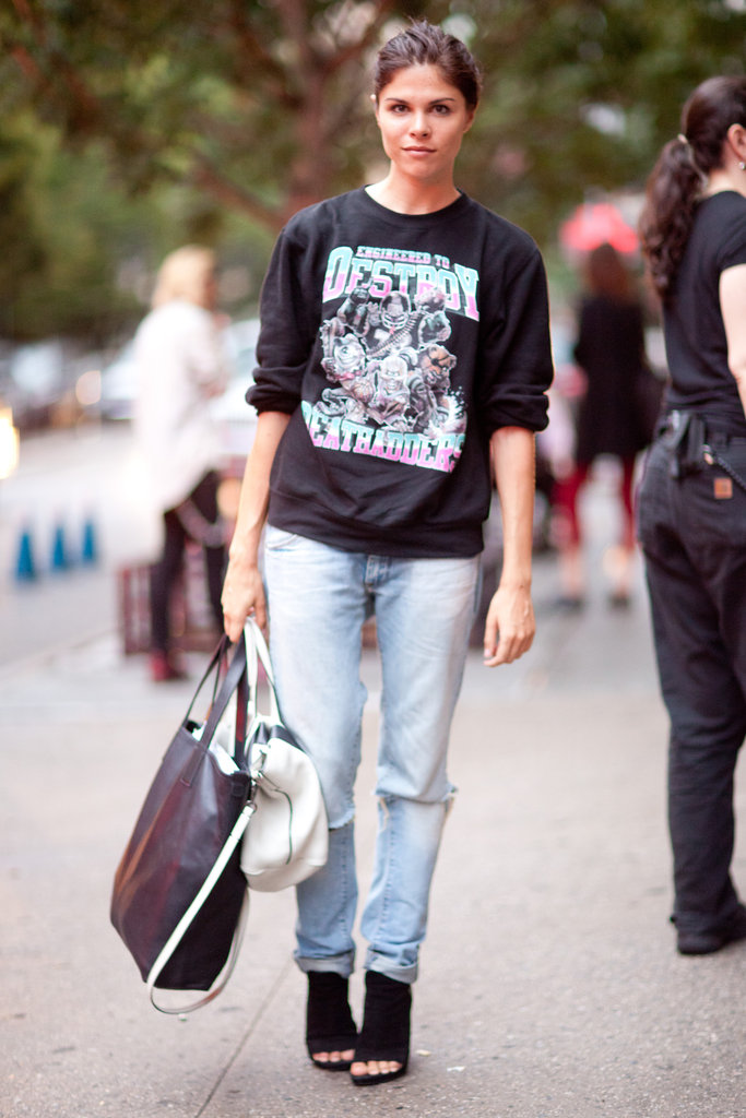 Acid-washed jeans and an old-school t-shirt got a dressed-up counter in open-toed booties and a chic, burgundy carry-all. Source: Adam Katz Sinding