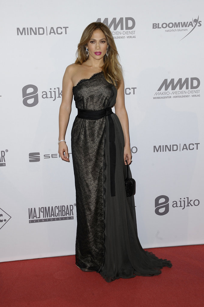 Jennifer Lopez amped up the glamour in a one-shouldered Lanvin gown at the UNESCO charity gala in Germany.