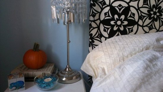 Pumpkin nightstand with velvet tufted headboard