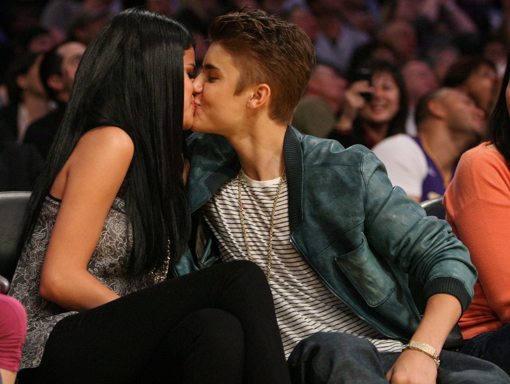 Kissing courtside in April 2012.