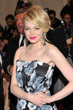 Draped in a black-and-white Lanvin print at the 2011 Met Gala, Emma opted for an electric shade of pink on her lips.