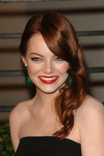 For the 2010 Vanity Fair Oscar Party, the actress went for a modern take on Old Hollywood glamour with glossy waves and a bright red lip look.