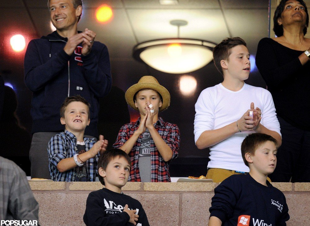 Cruz Beckham, Romeo Beckham, and Brooklyn Beckham applauded their dad at his soccer game.