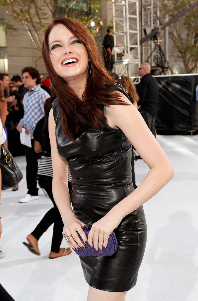 Emma Stone let out a big laugh in her black leather dress as she arrived to the MTV VMAs in September 2010.