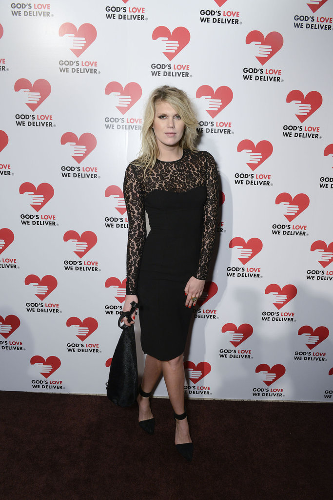 Alexandra Richards slipped into a body-conscious rendition of the black lace dress, with an intricate lace-inset neckline and sleeves.