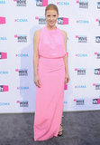 Quite the opposite of her dramatic sparkly black gown, Jessica Chastain struck a very sweet chord with this draped-neck cotton-candy-pink gown at the 2012 Critics' Choice Movie Awards.