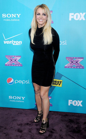Britney Spears wore a black dress and sandals to attend The X Factor finalists party in LA.