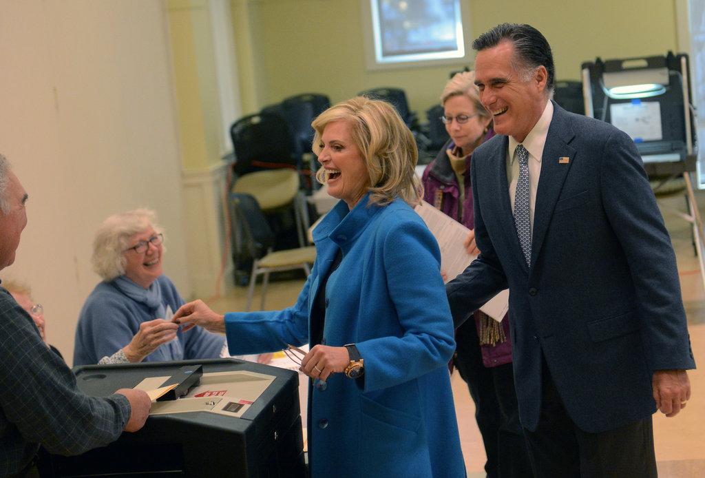 The Romneys were all smiles receiving their ballots.