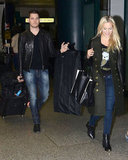 Michael Bublé walked through the airport with his wife.
