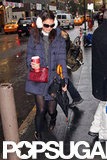 Katie Holmes bundled up to head to her Broadway show.