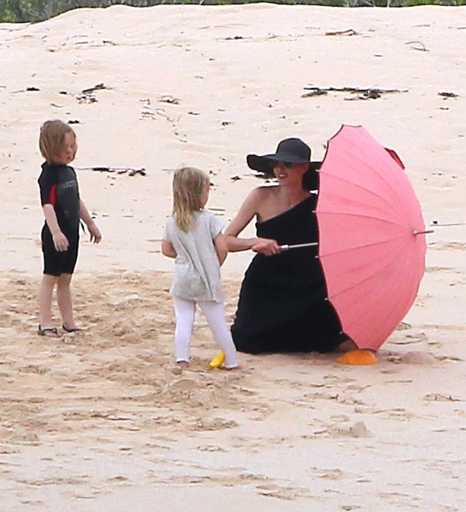 Angelina set up an umbrella on the beach in the Galapagos Islands for Knox and Vivienne Jolie-Pitt in April.