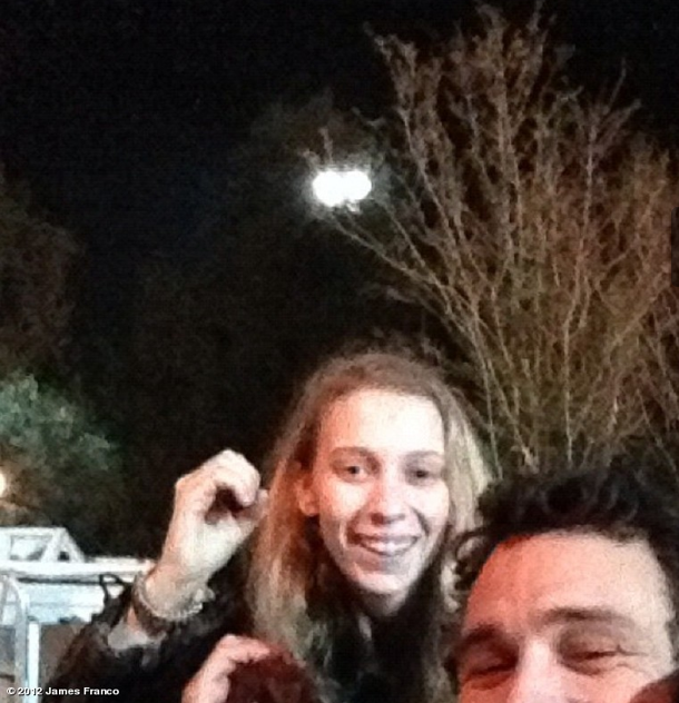 "James Franco celebrated by holding up ""O""'s for Obama with a friend. Source: JamesFranco on WhoSay"