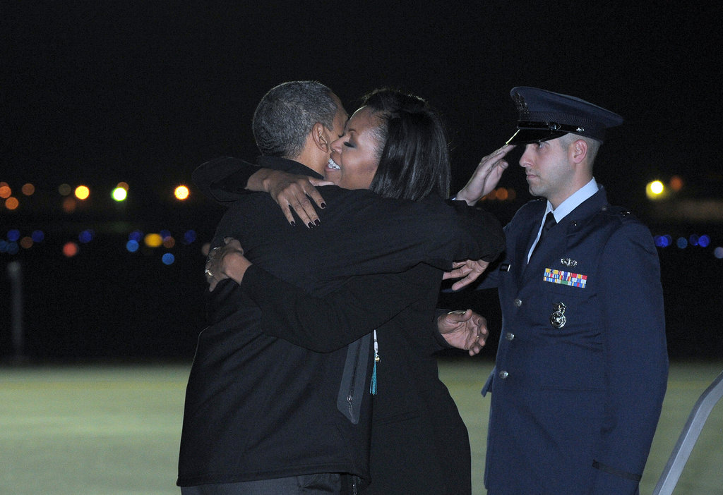 Michelle Obama hugged Barack on the eve of the election in Des Moines.