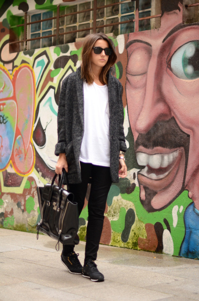 The look may be minimal, but a luxe bag and a pair of cool kicks give this black and gray mix some edge. Source: Lookbook.nu