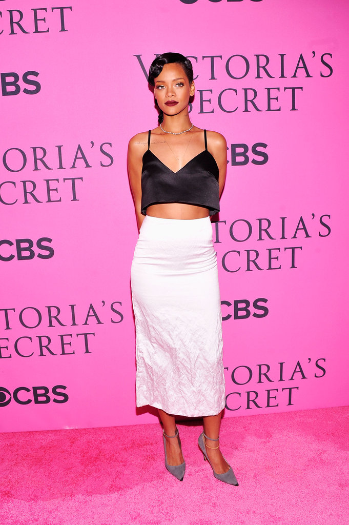 Rihanna was both elegant and sexy in a silky crop top and a white pencil skirt.