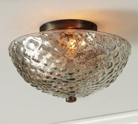 Even overhead lighting can cast a remarkably flattering glow with the right material. This Hobnail Mercury Glass Flushmount ($149) does the trick.