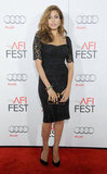 Eva Mendes solidified her bombshell status in a black lace Dolce & Gabbana dress at a Hollywood screening of Holy Motors.