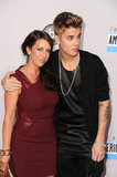 Justin Bieber had his arm around his mom.