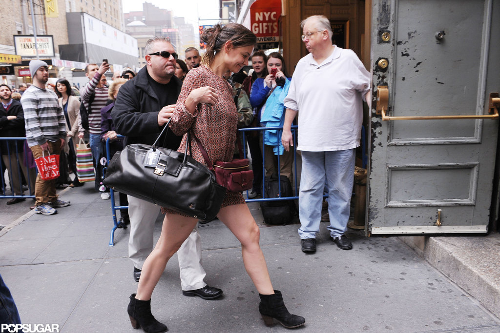 Katie Holmes got to her Broadway show wearing a short minidress.