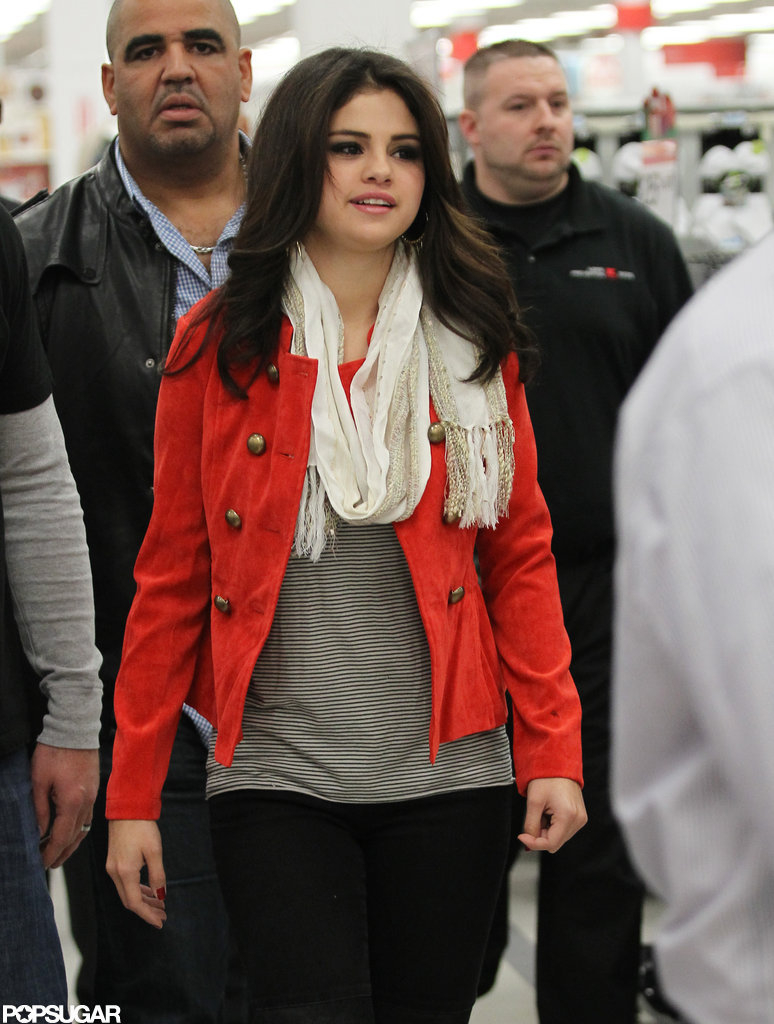 Selena Gomez wore a bright red jacket.