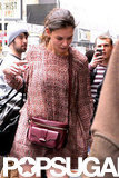 Katie Holmes wore a burgundy bag with a short minidress.