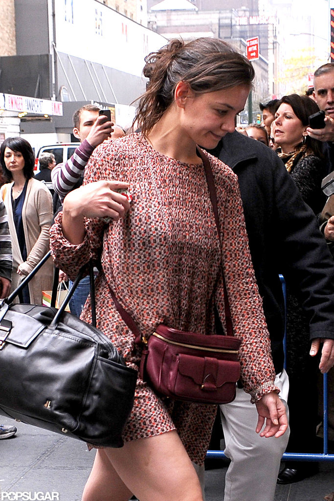 Katie Holmes donned a short dress to arrive at her show in NYC.