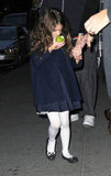 Suri Cruise ate an apple on the way to dinner with Katie Holmes.
