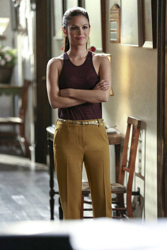 Zoe cinched her striped T by Alexander Wang tank ($92) and mustard 3.1 Phillip Lim trousers ($350) with an embellished Anthropologie belt.