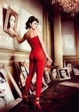 Penélope Cruz posed in a Michael Kors jumpsuit and acted out the superstitions of framed pictures falling off the wall.