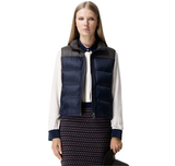 We're looking to this Club Monaco Tria puffer vest ($199) for a quick lesson in boyish charm. And we're totally loving the unexpected pairing of the vest with a blouse and pencil skirt, as this model shows.