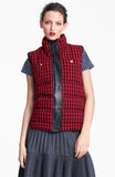 A preppier sensibility need not look further than this investment piece: Marni check-print puffer vest ($1,120). It's a little bit mountain-chic, a little bit collegiate, and perfect for mix and matching with stripes, checks, and other bold prints.