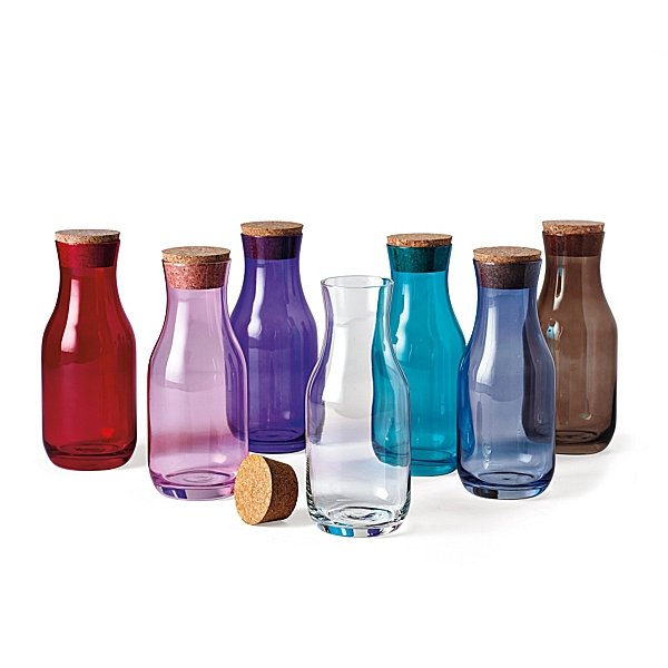 Whether it's filled with wine on a table or water on a nightstand, the vibrant hues of these Glass Carafes ($48) make them seem extra special.
