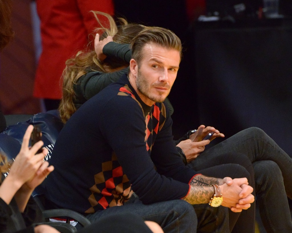 David Beckham sat on the edge of his seat.