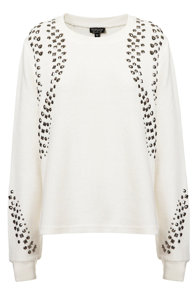 It's all about the strategic studding on this Topshop beaded textured sweatshirt ($90), and we're pretty sure the edgier styler would agree. If you're just grabbing drinks, this embellished option would go great with a black leather jacket and a fuller circle skirt.
