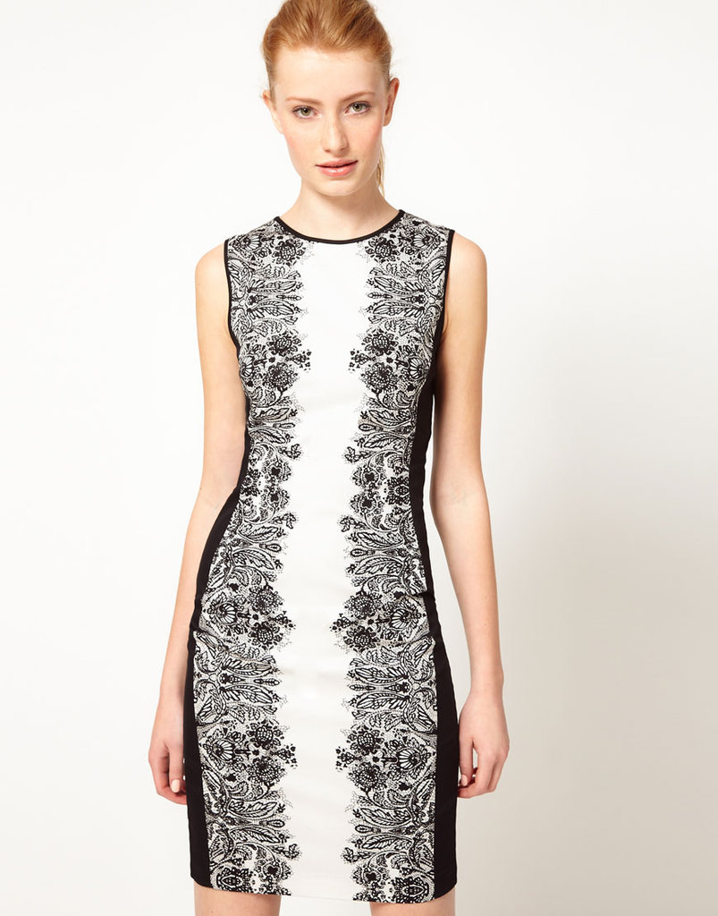 This Warehouse Mirror Floral Pencil Dress ($112) would be the perfect way to wear a little lace. The black lace print along the sides shaves inches off your figure; it would look fantastic with black tights and a blazer for heading from the office right out to a holiday cocktail party.
