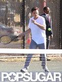 Leonardo DiCaprio aimed his racket at the ball.