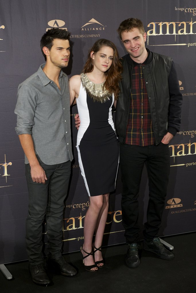 Taylor Lautner, Kristen Stewart and Robert Pattinson posed for photos at the Breaking Dawn — Part 2 photo call in Madrid.