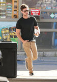Zac Efron carried a water bottle.