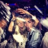 Cara Delevingne and a pal horsed around at a party. Source: Instagram user caradelevingne