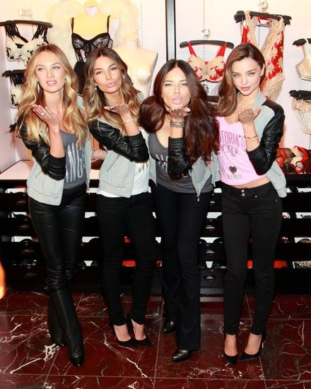 Miranda Kerr, Lily Aldridge, Adriana Lima, and Candice Swanepoel blew kisses for the camera at Victoria's Secret Herald Square in NYC.