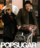 Carey Mulligan and husband Marcus Mumford touched down at LAX.