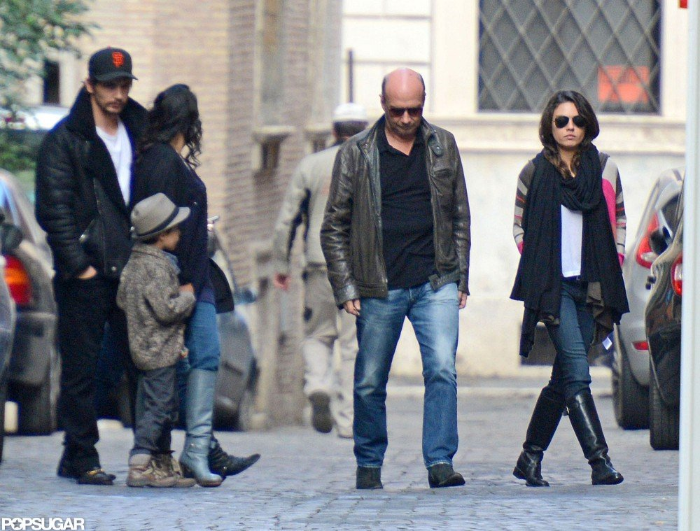 Mila Kunis wore black boots for a walk in Rome.