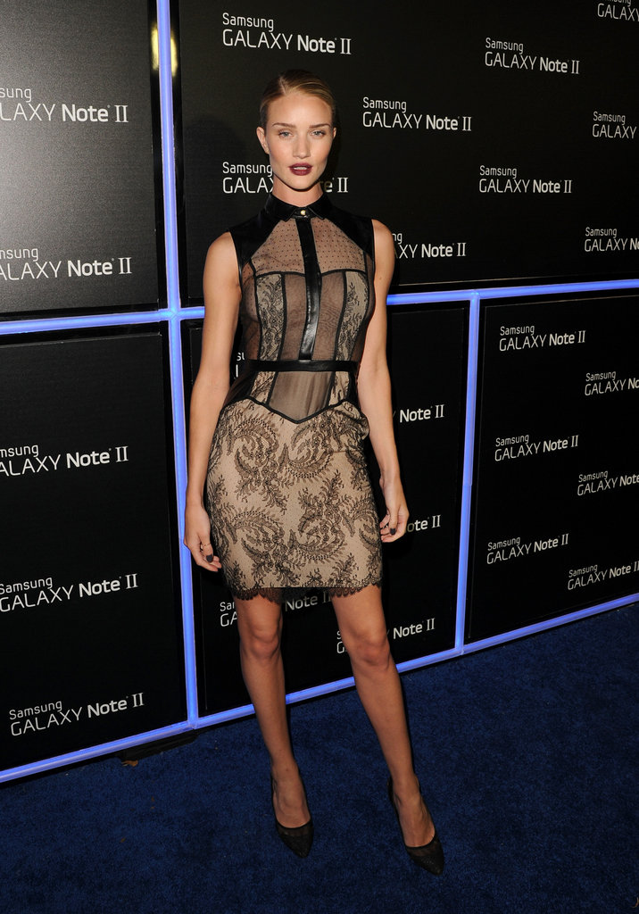 Rosie Huntington-Whiteley opted for something a little sexier via a body-con sheer and lace Jason Wu minidress.